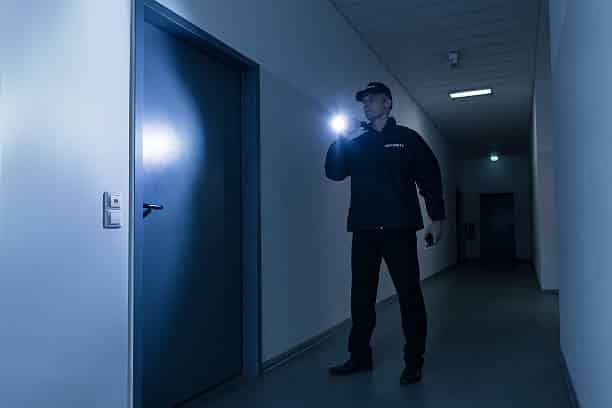 ssr security guard in Vancouver with a flashlight protecting a building