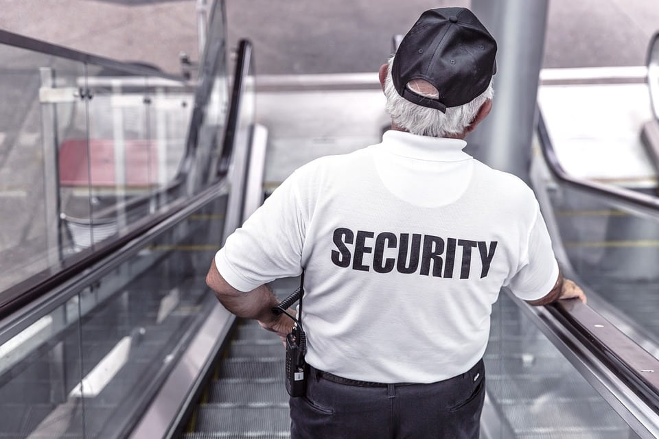 Security Guard on escalator - SSR Security and loss prevention serving Vancouver, Coquitlam and Burnaby